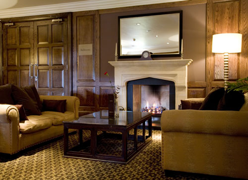 Relax by the fire in our main reception area