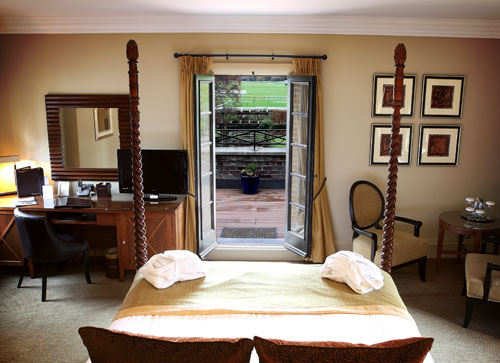 Beautiful French doors lead out from the bedroom to the balcony